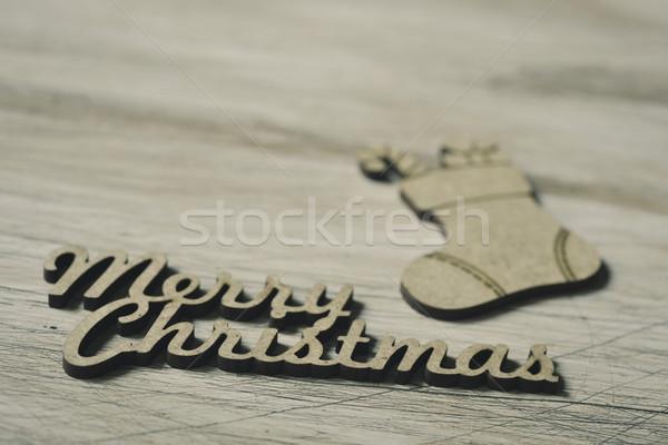 Szöveg vidám karácsony harisnya fából készült dísz Stock fotó © nito
