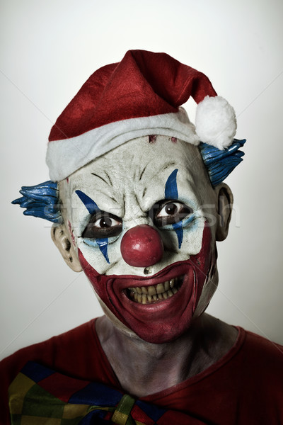 scary evil clown with a santa hat Stock photo © nito