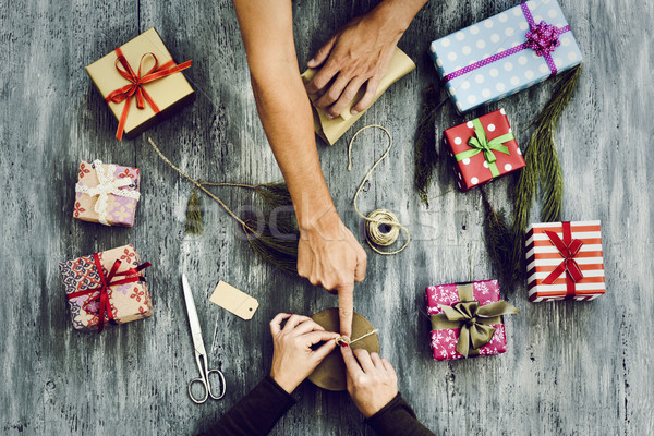 young woman and man wrapping gifts Stock photo © nito