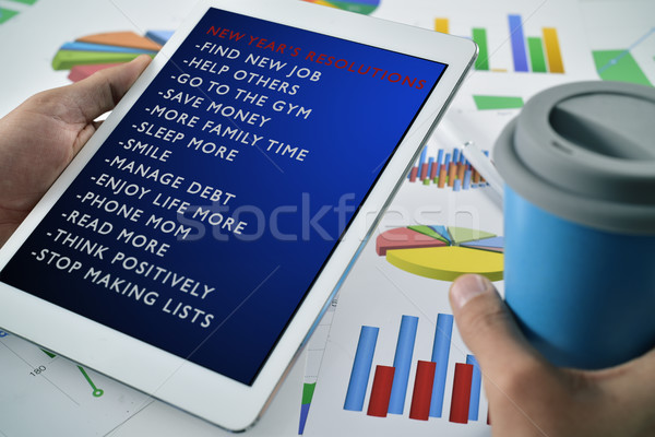 man with a list of new years resolutions Stock photo © nito