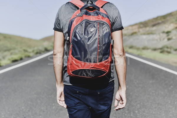 young backpacker man walking by a secondary road Stock photo © nito