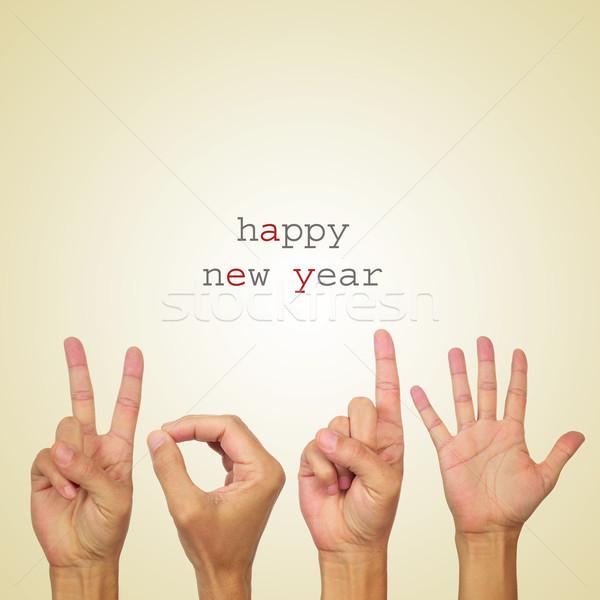 Gelukkig nieuwjaar 2015 tekst man handen aantal Stockfoto © nito
