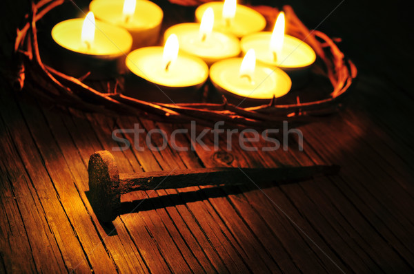 the crown of thorns on the holy cross and some lit candles, with Stock photo © nito