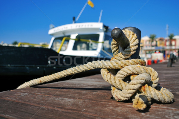 boat tied with a rope on a mooring Stock photo © nito