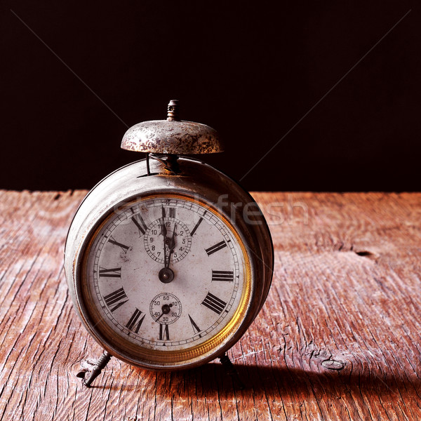 Stock photo: old alarm clock on a rustic wooden table