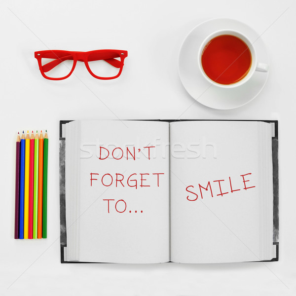 text dont forget to smile written in a notepad Stock photo © nito