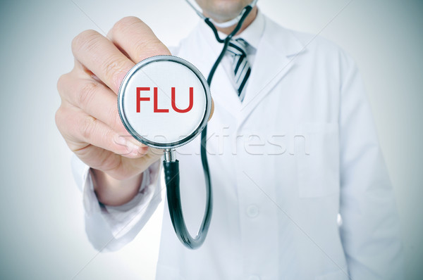 doctor with a stethoscope with the word flu, vignetted Stock photo © nito