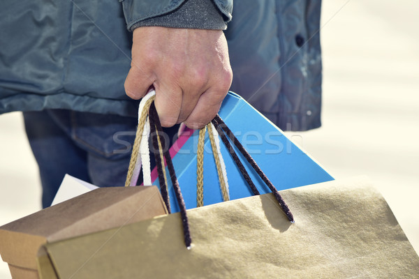 young man carrying some shopping bags Stock photo © nito