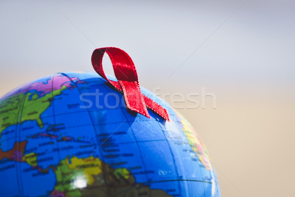 world globe with a red ribbon for the fight against AIDS Stock photo © nito