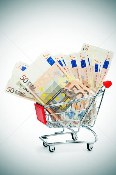 euro banknotes in a shopping cart Stock photo © nito