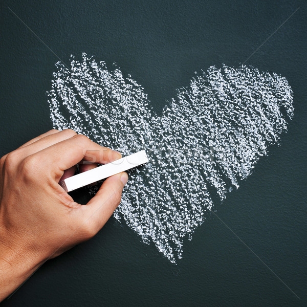Coração homem mão desenho giz quadro-negro Foto stock © nito