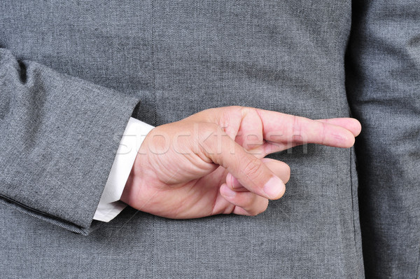 man in suit crossing his fingers in his back Stock photo © nito