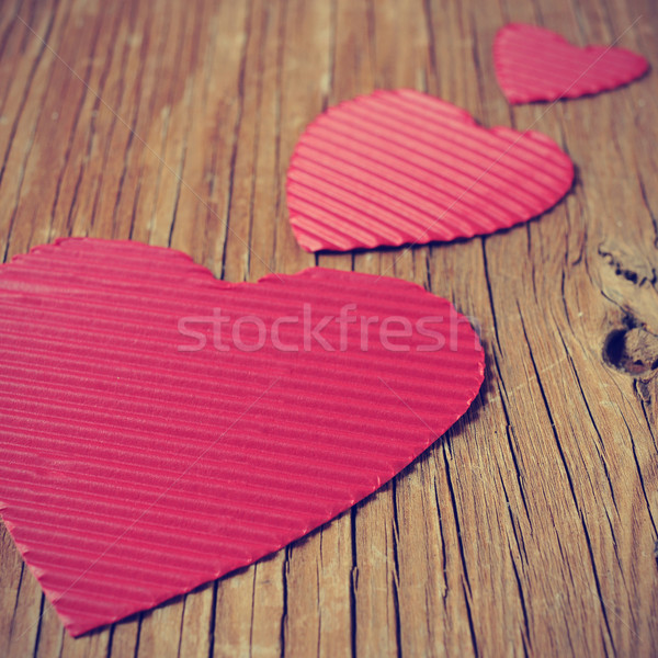 red hearts on a rustic wooden surface, with a filter effect Stock photo © nito