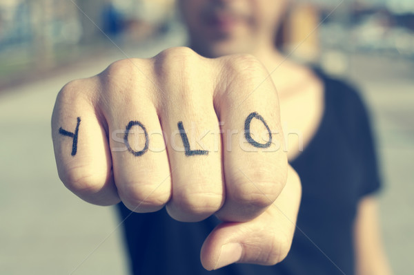 young man with the word yolo, for you only live once, tattooed i Stock photo © nito