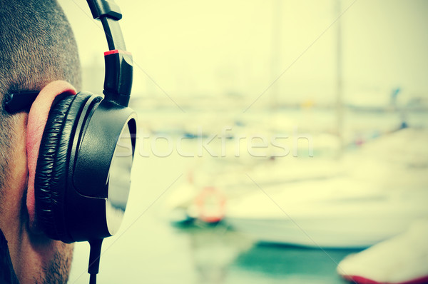young man listening to music  in front of the sea, with a filter Stock photo © nito