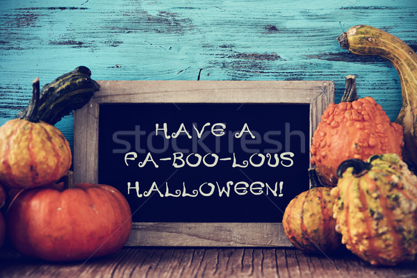 pumpkins and chalkboard with text have a fa-boo-lous halloween Stock photo © nito