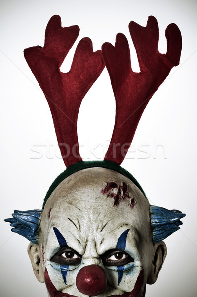 scary evil clown with reindeer antlers headband Stock photo © nito