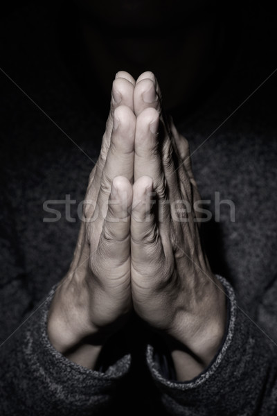 man praying with his hands put together Stock photo © nito