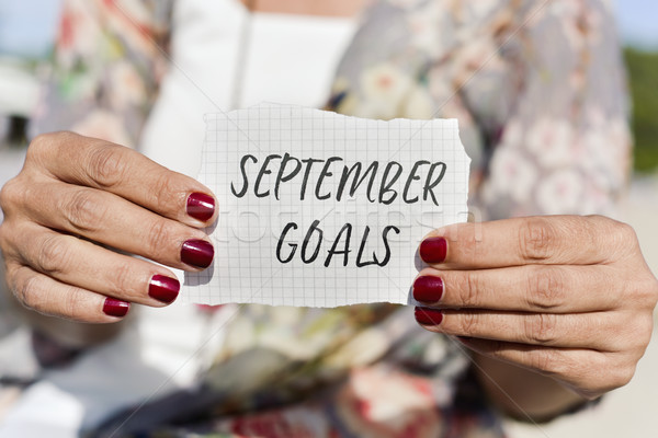 woman with a note with the text september goals Stock photo © nito