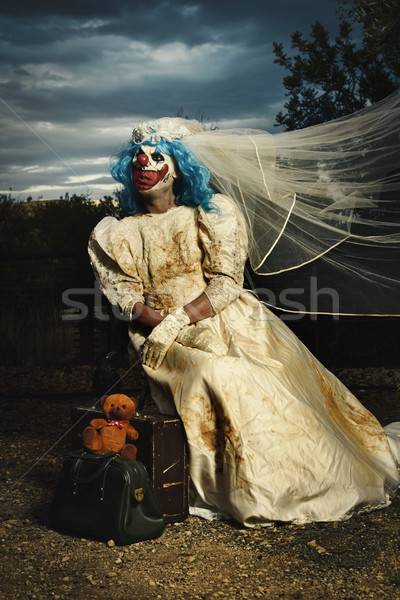 scary evil clown in a bride dress at dusk Stock photo © nito