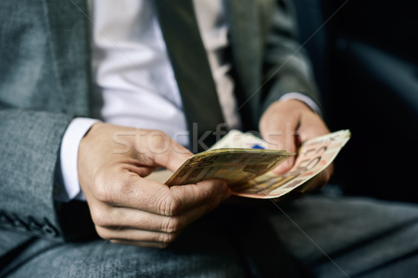 man counting euro bills in the back of a car Stock photo © nito