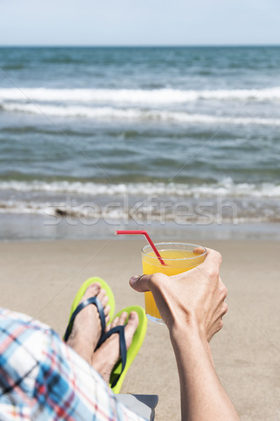 young man relaxing on the beach Stock photo © nito