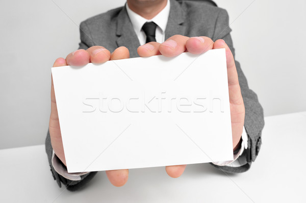 man in suit holding a blank signboard Stock photo © nito