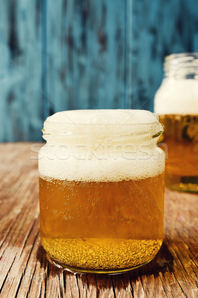 beer served in glass jars Stock photo © nito