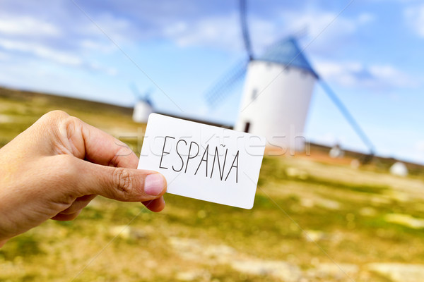 man shows a signboard with the word Espana, Spain, in front of t Stock photo © nito