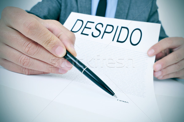 man shows a document with the text despido, dismissal in spanish Stock photo © nito