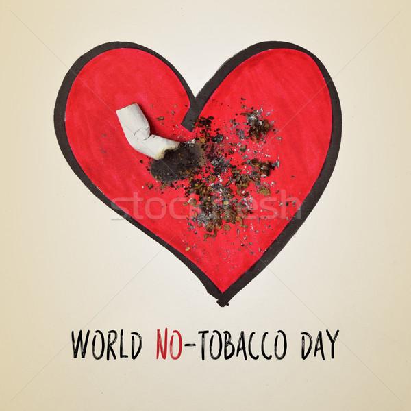 Cigarrillo trasero texto mundo día fuera Foto stock © nito