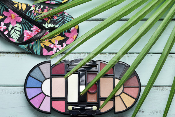 flip-flops, eye shadow palette and palm leaf Stock photo © nito