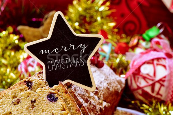 fruitcake topped with a signboard with the text merry christmas Stock photo © nito