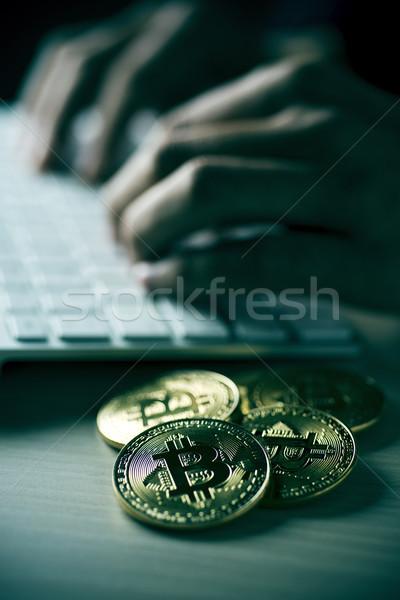 pile of bitcoins and man using computer Stock photo © nito
