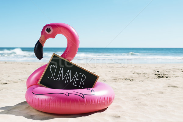 flamingo swim ring on the beach and text summer Stock photo © nito