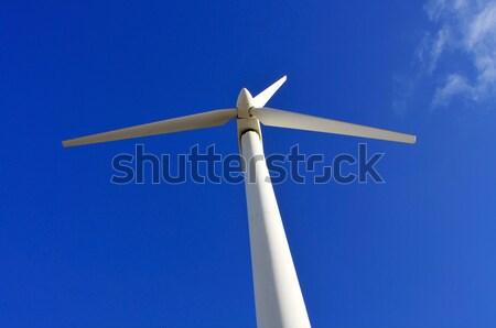 Rüzgar türbini görmek mavi gökyüzü gökyüzü Bina mavi Stok fotoğraf © nito