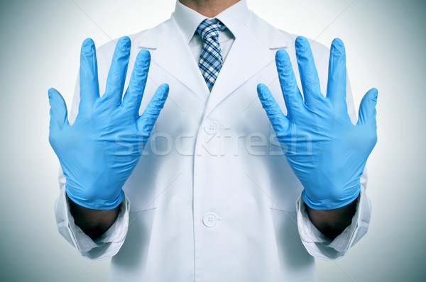 a doctor with medical gloves Stock photo © nito