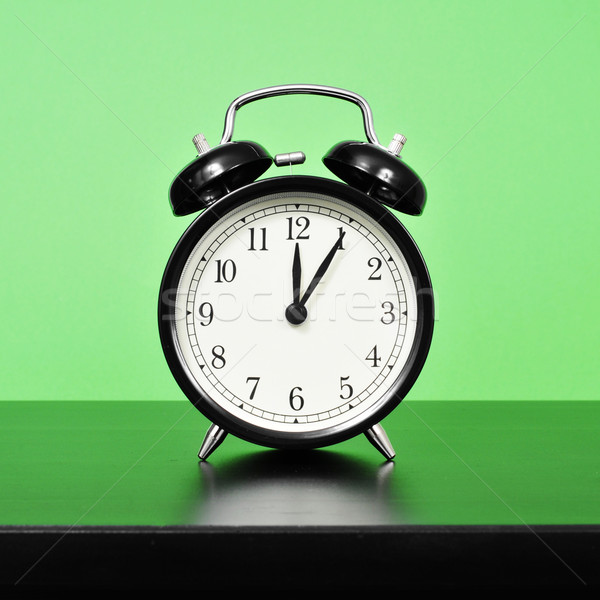 mechanical alarm clock on a bedside table Stock photo © nito