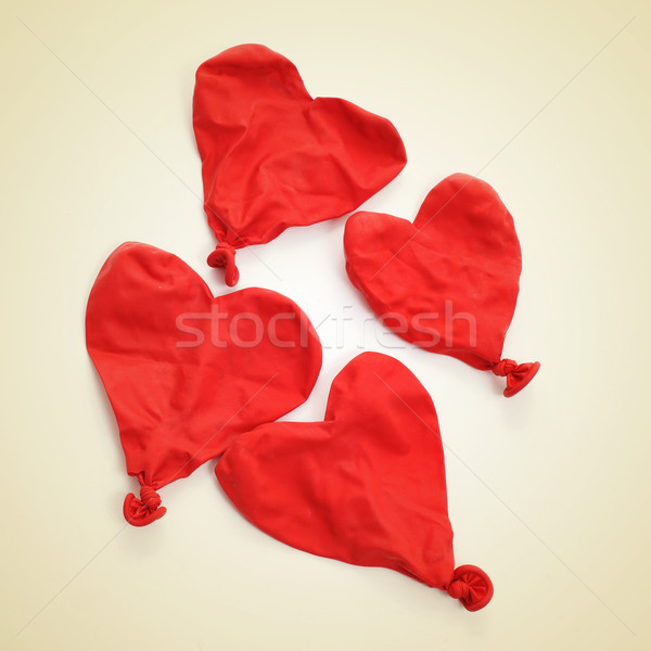 deflated heart-shaped balloons, with a retro effect Stock photo © nito