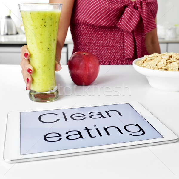 young woman and clean eating: oatmeal cereal, apple and smoothie Stock photo © nito