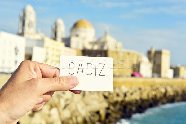 man shows a signboard with the word Cadiz, in Cadiz, Spain Stock photo © nito