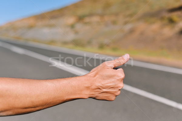 young man hitchhiking Stock photo © nito