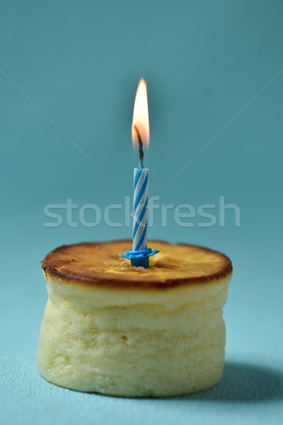 lit birthday candle on a cheesecake Stock photo © nito
