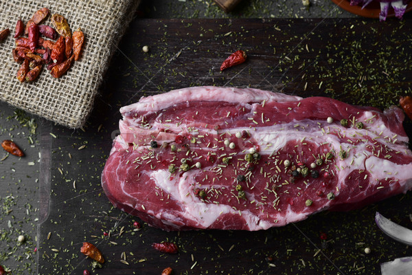 raw strip steak seasoned with different spices Stock photo © nito