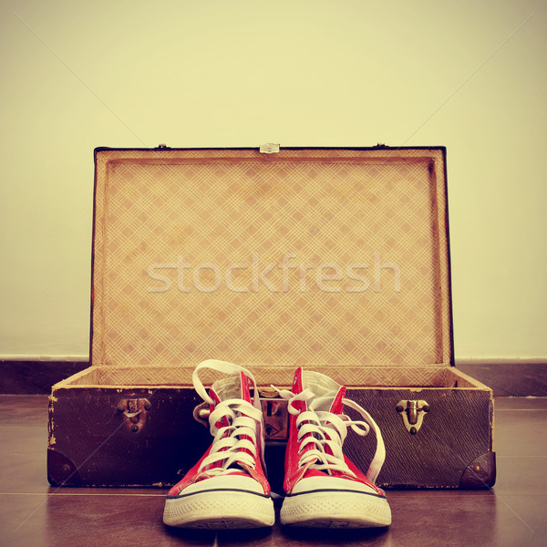 sneakers and old suitcase Stock photo © nito