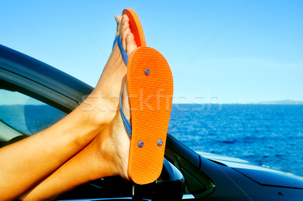 young man wearing flip-flops relaxing in a car near the ocean Stock photo © nito