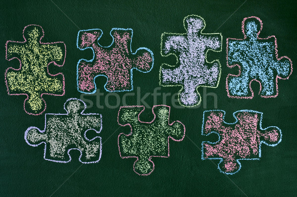 puzzle pieces of different colors drawn on a chalkboard, as the  Stock photo © nito