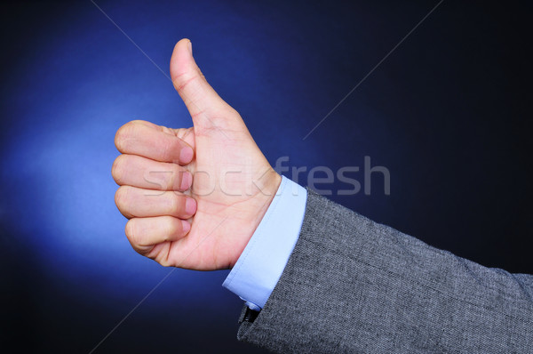 young businessman giving a thumbs-up sign Stock photo © nito