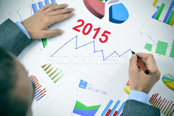 businessman observing a chart with an upward trend during 2015 Stock photo © nito