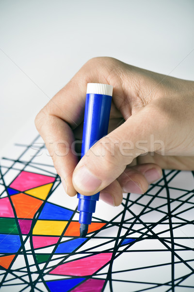 young man coloring a drawing, designed by myself Stock photo © nito